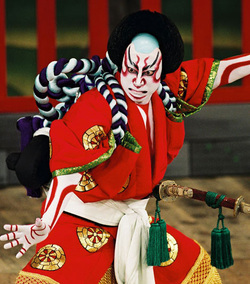 kabuki theater actors. kabuki is a theater about legends. when actors paint their entire bodies white and put special markings, they dress elaborately act in z